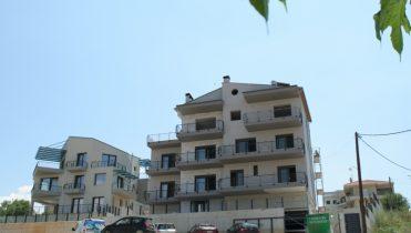 Трехэтажное здание с подвалом
